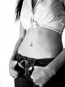 stock photo of pierced belly button  - teen girl in jeans with attitudem black and white - JPG