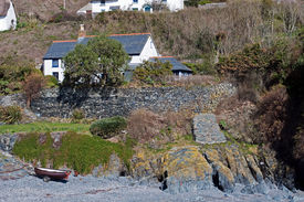 picture of safe haven  - The small rocky beach at Cadgwith Cove in Cornwall provides a safe haven for fishing boats and small craft - JPG