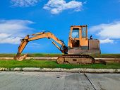 stock photo of heavy equipment operator  - Heavy Duty Construction Equipment Parked at Worksite - JPG
