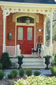 picture of victorian houses  - front door entrance to victorian home with red doors - JPG