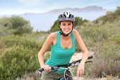 Portrait of smiling girl riding sports bike