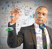 stock photo of multitasking  - Businessman drawing a new project with a pen - JPG