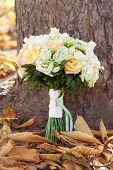 bridal bouquet and autumn leaves