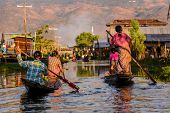 foto of row houses  - Burmese women rowing on wooden boats Inle Lake Myanmar  - JPG