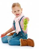 stock photo of montessori school  - Little girl holding a bunch of grapes - JPG