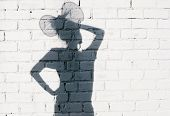 foto of fool  - Funky girl fooling around on the brick wall background - JPG