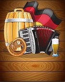 foto of accordion  - Accordion beer barrel glass pretzel and German flag on a wooden background - JPG