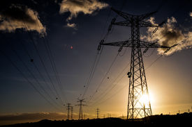 picture of electricity pylon  - Energy Electricity Power Pylon on a Blue Sky - JPG