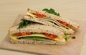 foto of tomato sandwich  - Club sandwich with sausages tomato and cheese - JPG