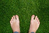 picture of foot  - Mens feet standing on grass close up - JPG