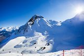 stock photo of caucus  - Sunny winter landscape of Caucasus mountains during daytime in Sochi ski resort Krasnaya polyana - JPG