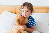 image of teddy  - Cute toddler boy in a bed after shower - JPG