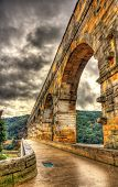 stock photo of aqueduct  - HDR image of Pont du Gard ancient Roman aqueduct listed in UNESCO - JPG