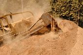 picture of bulldozers  - Large bulldozer excavating top soil for later use on a new commercial construction development project - JPG