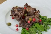 stock photo of deer meat  - Roasted venison meat with ruccola and cranberries - JPG