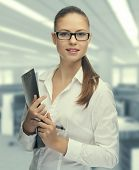 image of secretary  - Young woman secretary at work at the office - JPG