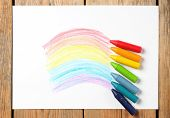 foto of montessori school  - Crayons lying on a paper with children - JPG