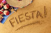 foto of maracas  - The word Fiesta written in sand on a Mexican beach with sombrero straw hat traditional serape blanket starfish and maracas - JPG