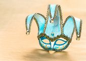 foto of venetian carnival  - Blue venetian carnival mask over golden background - JPG