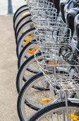 stock photo of zero  - Bicycle rental station in a city zero emission transport  - JPG