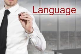 foto of pronunciation  - businessman in office writing language in the air - JPG