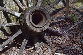 pic of wagon  - This is a weathered antique wagon wheel from the 1800s that would make a great background image - JPG
