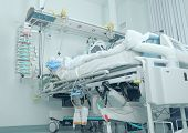 stock photo of intensive care  - Modern bed in the intensive care with patient - JPG