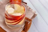foto of cider apples  - Glass of apple cider with fruits and cinnamon on table close up - JPG