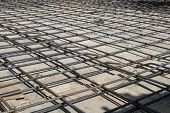picture of concrete pouring  - Steel bars mesh reinforcement before pouring concrete - JPG
