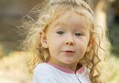 image of kinky  - Portrait of a beautiful little girl with kinky hair. Shallow DOF portrait style. ** Note: Slight blurriness, best at smaller sizes - JPG