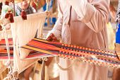 picture of nomads  - A man produces the fabric on a traditional loom in the Bedouin village Egypt - JPG