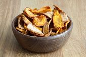 pic of parsnips  - Detail of fried carrot and parsnip chips in rustic wood bowl - JPG