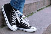 pic of street-walker  - Female feet in gumshoes on  stone stairs - JPG
