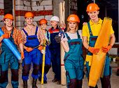 pic of millwright  - Happy group people men and women in builder uniform - JPG