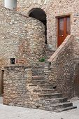 pic of stone house  - stairs of house in stone with door - JPG