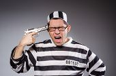 pic of prison uniform  - Funny prisoner with firearm isolated on gray - JPG