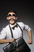 pic of moustache  - Young man with false moustache holding case  isolated on gray - JPG