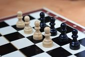 image of chessboard  - Battle of pawns on the chessboard concept - JPG