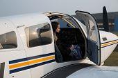 stock photo of single woman  - Woman pilot of the single engine piston aircraft - JPG