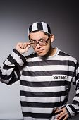 picture of prison uniform  - Funny prisoner isolated on gray - JPG