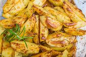 foto of baked potato  - Baked potatoes with fresh herbs in glass vessel - JPG