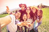 pic of mans-best-friend  - Best friends taking selfie at countryside picnic  - JPG