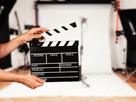 stock photo of studio  - Man hands holding film clapper - JPG