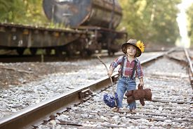picture of hobo  - Adorable toddler dressed as a hobo and walking the railroad tracks - JPG