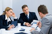 picture of business meetings  - Business team working and discussing together their business plan at meeting in office - JPG