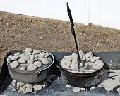 picture of dutch oven  - Aluminum and Cast Iron Dutch Ovens along with a lid lifter - JPG
