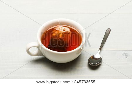 poster of Mug Filled With Hot Water And Dipped Bag Of Black Tea. Mug Filled With Boiling Water, Teabag And Spo