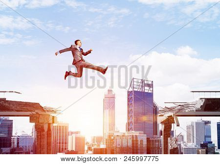 poster of Businessman Jumping Over Gap With Flying Letters In Concrete Bridge As Symbol Of Overcoming Challeng