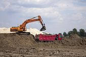 Photo Of Excavator And Dumper Truck. Construction Site Digger. Industrial Machinery On Building Site poster