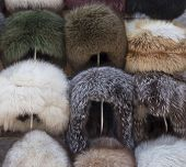 Fur Caps Winter Headwear. Trading With Fur Hat. Selling Natural Winter Fur Headdress poster